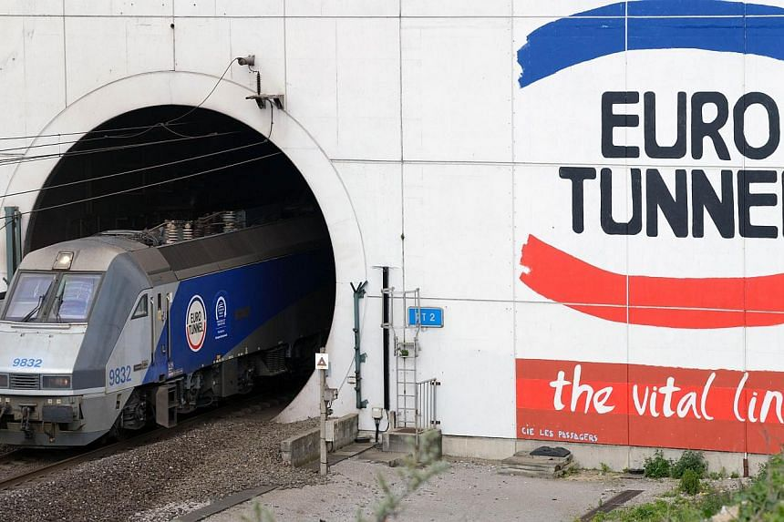 A EuroTunnel train comes out of the Channel Tunnel, owned by EuroTunnel in Coquelles, northern France, on April 10, 2014. -- FILE PHOTO: AFP
