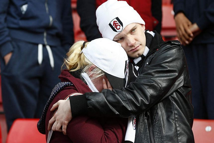 Despondent Fulham fans after the match against Stoke City at the Britannia stadium in Stoke on May 3, 2014. -- PHOTO: REUTERS
