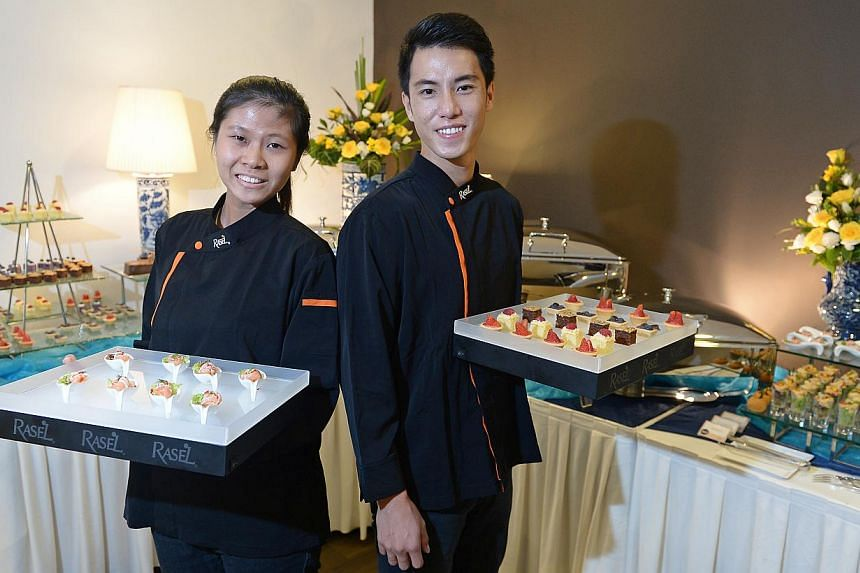 NUS undergraduates Jonathan Seah, 24, and Liew Ying Ying, 21, are part of a pool of 10 regular part-timers working for Rasel catering. -- ST PHOTO: NG SOR LUAN