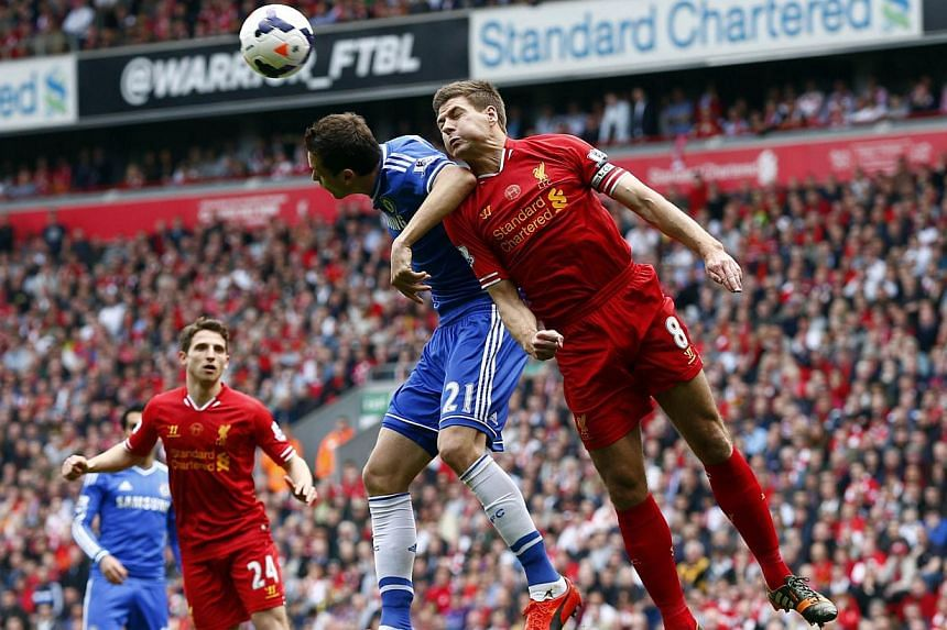 Liverpool's Steven Gerrard (right) challenges Chelsea's Nemanja Matic during their English Premier League soccer match at Anfield in Liverpool, northern England on April 27, 2014. -- FILE PHOTO: REUTERS