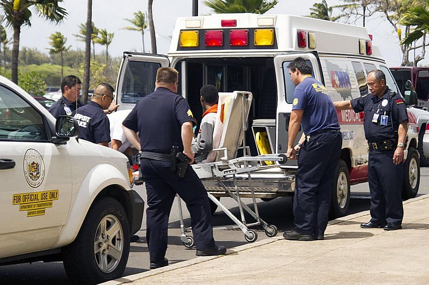 A 16-year-old boy is carried on a stretcher in Maui, Hawaii, April 20, 2014, as seen in this handout photo courtesy of Chris Sugidono,The Maui News. -- FILE PHOTO: AFP