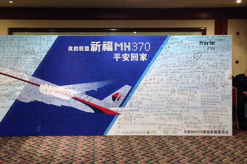A board written with messages for passengers onboard the missing Malaysia Airlines Flight MH370 at Lido Hotel in Beijing on May 2, 2014. -- PHOTO: REUTERS