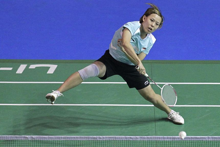 Singapore's Gu Juan returns a shot against India's Saina Nehwal in the first round women's singles match of the Li-Ning Singapore Open 2013 at the Singapore Indoor Stadium on June 19, 2013. Gu is leaving the national team, after tendering her resigna