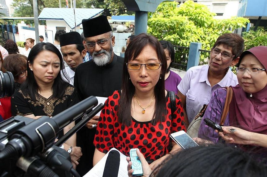Malaysian opposition legislator Teresa Kok (centre) meeting the press after lodging a police report at the Tun H. S. Lee police station in Kuala Lumpur on 7 February 2014.Malaysian opposition MP Teresa Kok is expected to be charged in the Duta