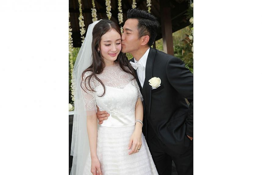 Hong Kong actor Hawick Lau kissing his bride, Chinese television star Yang Mi at their wedding in Bali on Jan 8, 2014. -- FILE PHOTO: APPLE DAILY