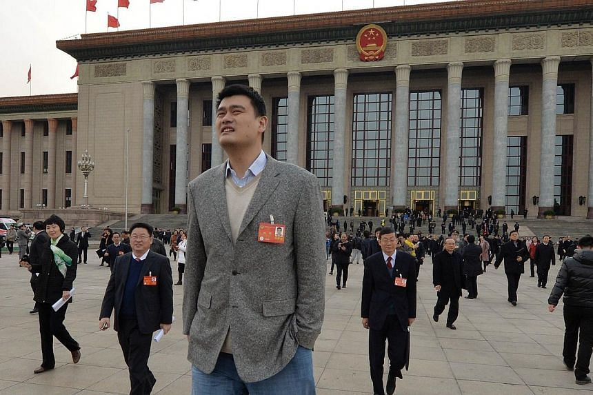 Basketball star Yao Ming, who is a delegate for Shanghai, leaves the Great Hall of the People after a session of the Chinese People's Political Consultative Conference in Beijing on March 7, 2014. -- FILE PHOTO: AFP