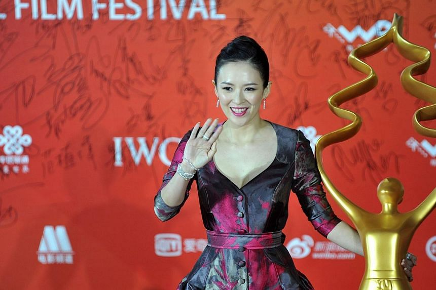 This picture taken on April 23, 2014 shows Chinese actress Zhang Ziyi arriving on the red carpet for the Beijing International Film Festival awards ceremony in Beijing. -- FILE PHOTO: AFP