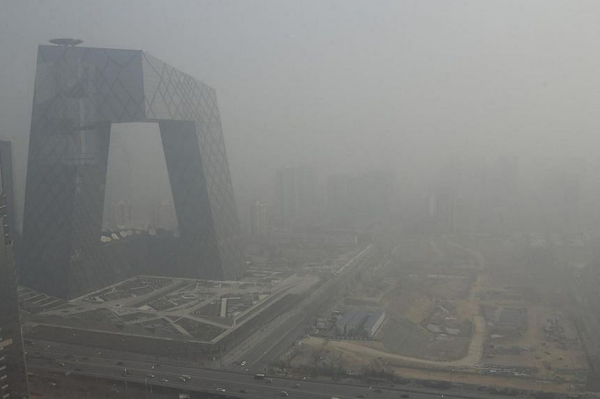 Authorities in Beijing (above) fined 652 industrial facilities for breaching environmental regulations in the first four months of the year as the Chinese capital stepped up efforts to fight pollution. -- FILE PHOTO: REUTERS
