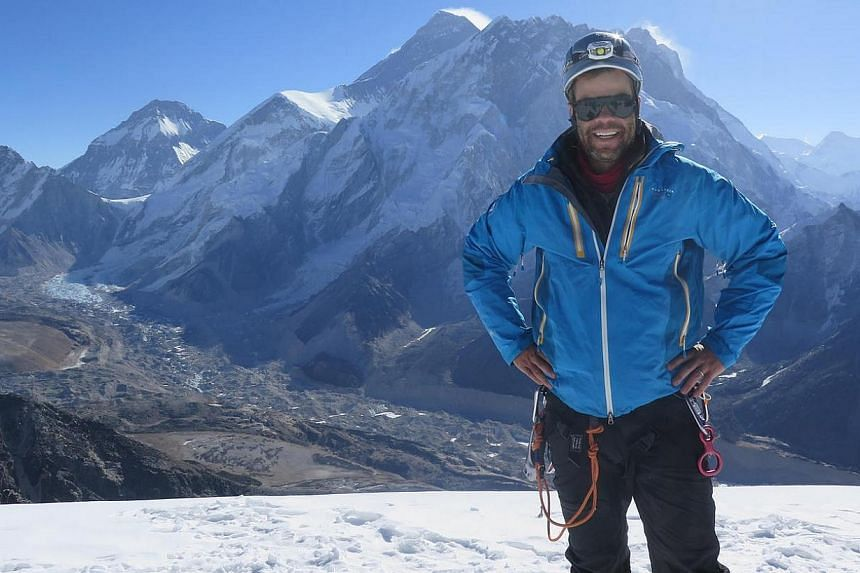 At the summit of Lobuche, with Mount everest in the background.  Mr Brooks Entwistle grew up climbing mountains in Colorado and has scaled several peaks. --  PHOTO: BROOKS ENTWISTLE