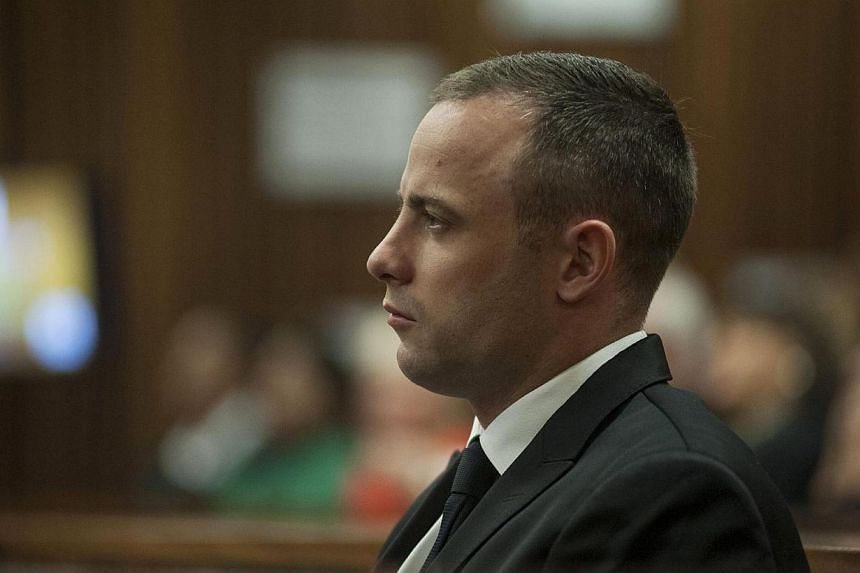 South African Paralympic athlete Oscar Pistorius sits in his dock during his ongoing murder trial, in Pretoria, South Africa on May 5, 2014.South African Paralympic and Olympic track star Oscar Pistorius returned to court on Monday, May 5, 2014