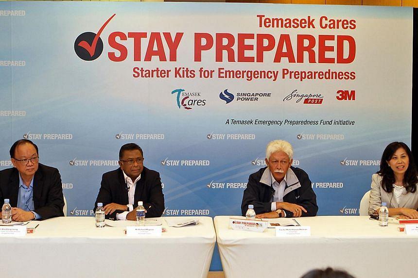 (From left) Mr Woo Keng Leong, EVP, Head of Postal Services, Singapore Post; Mr Richard Magnus, Chairman Temasek Cares; Tan Sri Mohd Hassan Marican, Chairman Singapore Power; Ms Helen Foo, GM Safety & Graphics Group, 3M.-- PHOTO: TEMASEK CA