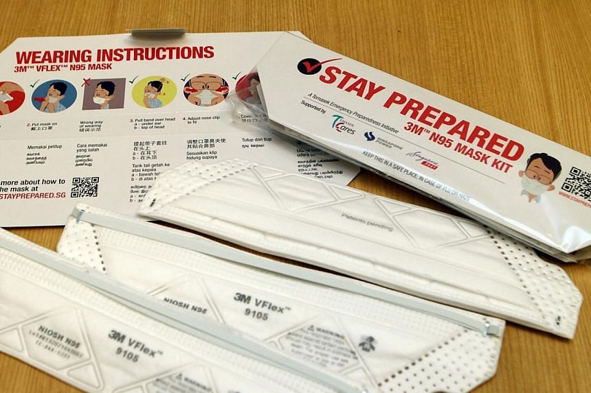 The starter kit from Temasek cares, which contains three N95 masks-- PHOTO: TEMASEK CARES