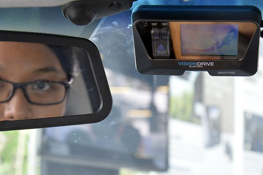 The in-vehicle video recording system will be rolled out in police fast-response cars islandwide starting next month. -- ST PHOTO: DESMOND FOO