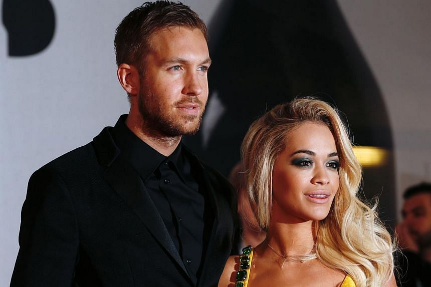 British DJ Calvin Harris (left) and British singer-songwriter Rita Ora (right) pose on the red carpet arriving at the BRIT Awards 2014 in London on Feb 19, 2014. -- FILE PHOTO: AFP