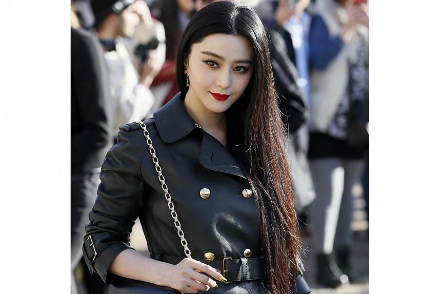 Chinese actress Fan Bingbing poses upon arrival prior at the Louis Vuitton 2014/2015 Autumn/Winter ready-to-wear collection fashion show in Paris on March 5, 2014. -- PHOTO: AFP