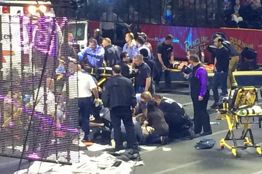 Emergency personnel attend to Ringling Bros. and Barnum & Bailey Circus performers who were injured when the scaffolding they were performing from collapsed in Providence, Rhode Island, May 4, 2014. A scaffolding collapsed during a circus perform