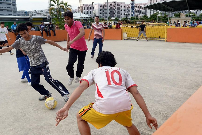 Foreign workers playing street soccer at the Singapore Contractors Association Limited (Scal) Recreation Centre in Soon Lee Road in Jurong West, on Dec 16, 2012. The centre was built to cater to foreign workers.Foreign workers will be able to r