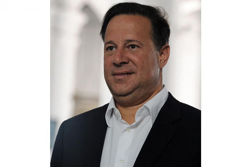 Panamanian presidential candidate for the Panamenista Party (PP), Juan Carlos Varela, smiles in Panama City, on May 3, 2014, on the eve of presidential elections. -- FILE PHOTO: AFP