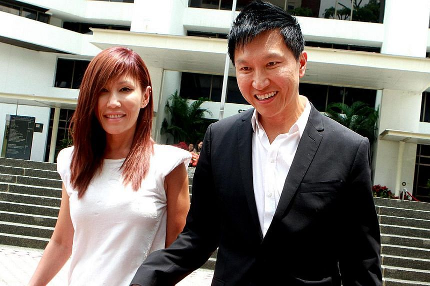 Kong Hee (right) and his wife Ho Yeow Sun leaving at the Court for the City Harvest Church trial. -- ST FILE PHOTO: LAU FOOK KONG