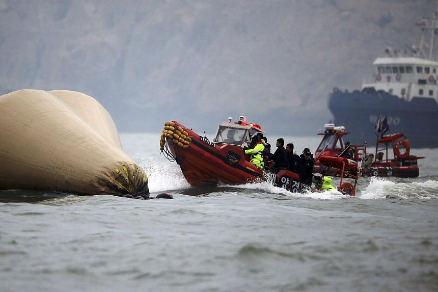 South Korean rescue workers operate near floats where the capsized passenger ship Sewol sank during a rescue operation in Jindo on April 27, 2014. -- FILE PHOTO: REUTERS