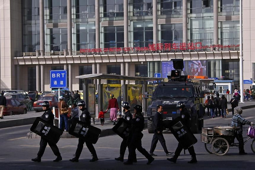 Armed police patrol at the entrance of the South Railway Station, where three people were killed and 79 wounded in Wednesday's bomb and knife attack, in Urumqi, Xinjiang Uighur Autonomous region, May 2, 2014. -- FILE PHOTO: REUTERS