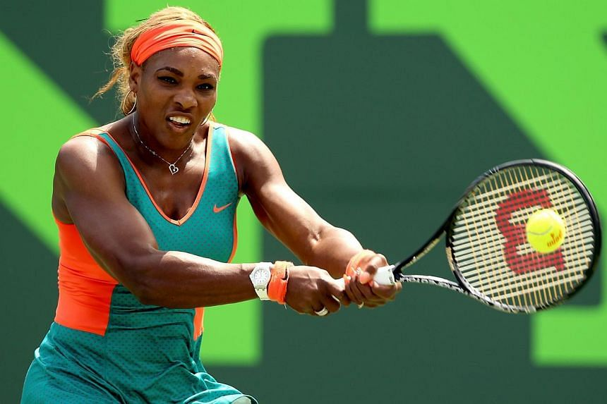 Serena Williams returns a shot to Maria Sharapova of Russia during the Sony Open at the Crandon Park Tennis Center on March 27, 2014 in Key Biscayne, Florida. -- FILE PHOTO: AFP