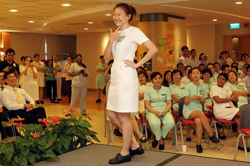 Staff at Singapore General Hospital (SGH), including Staff Nurse Yeo Pei Wen Grace, strut their stuff down the catwalk on May 5, 2014. In conjunction with World Hand Hygiene Day, the SGH staff models showcases styles that can be implemented under a n