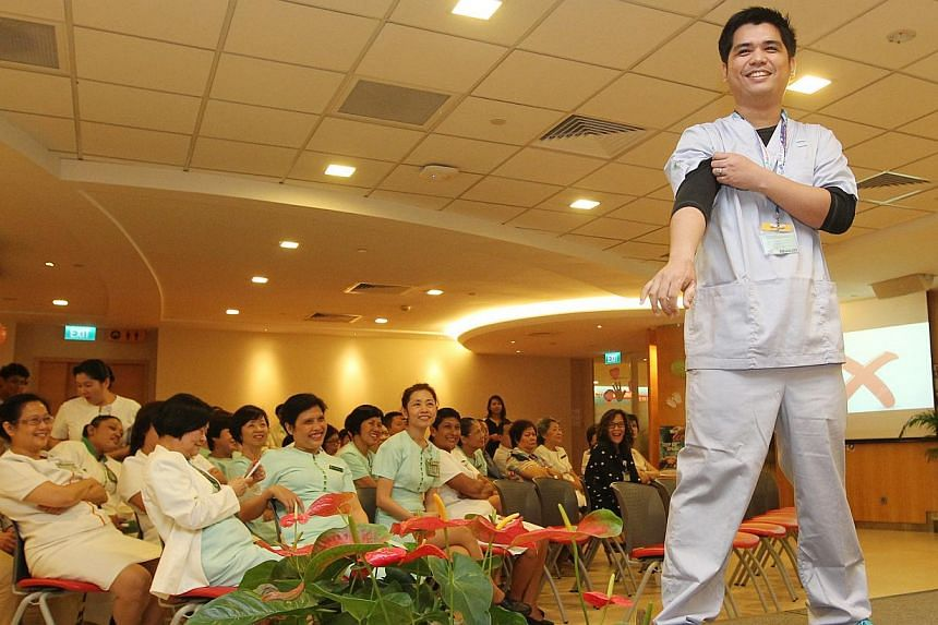 Staff at Singapore General Hospital (SGH), including Staff Nurse Eliz Michael Acedo Pelayo, strut their stuff down the catwalk on May 5, 2014. In conjunction with World Hand Hygiene Day, the SGH staff models showcases styles that can be implemented u