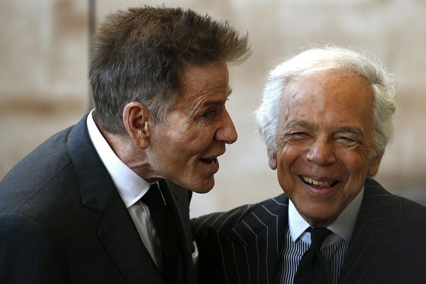 Fashion designers Calvin Klein (left) and Ralph Lauren greet each other as they attend a ceremony to open the Anna Wintour Costume Center at the Costume Institute at the Metropolitan Museum of Art in New York on May 5, 2014. -- PHOTO: REUTERS