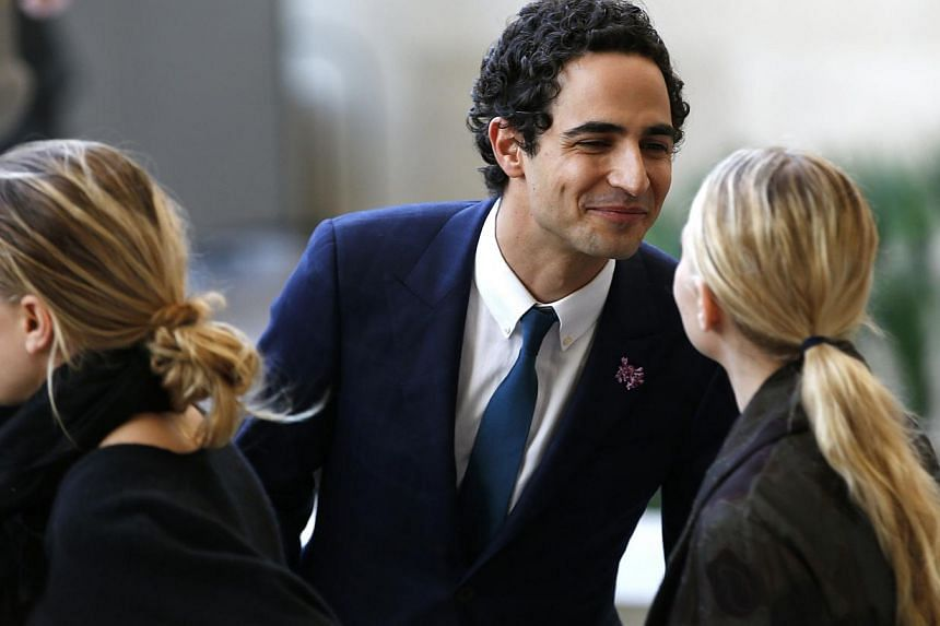 Fashion designer Zac Posen (centre) greets actresses and designers Mary-Kate (left) and Ashley Olsen as they attend a ceremony to open the Anna Wintour Costume Center at the Costume Institute at the Metropolitan Museum of Art in New York on May 5, 20