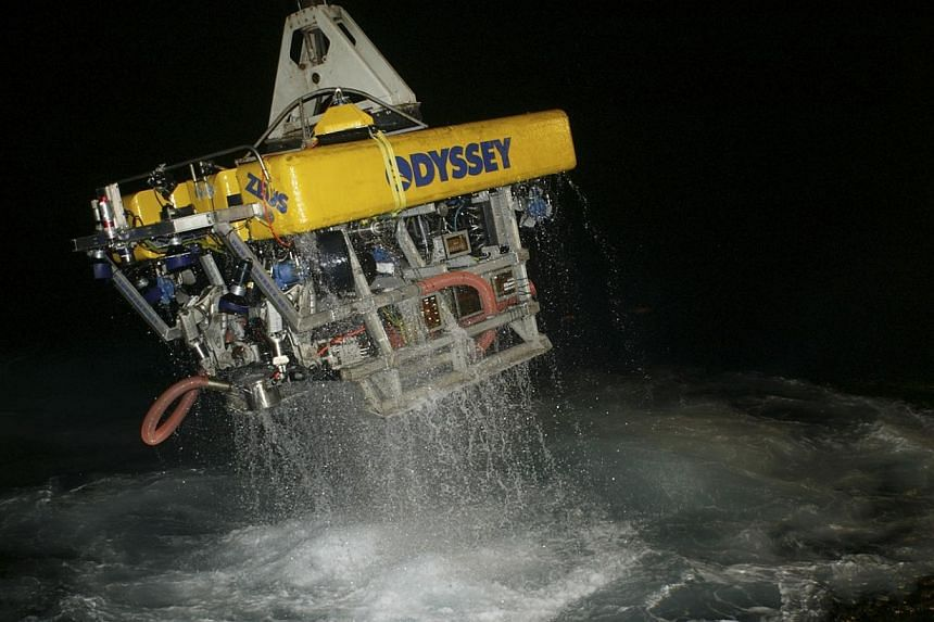 Odyssey's remotely operated vehicle (ROV) Zeus returns to the surface following work on a deep-ocean shipwreck site in this undated handout provided by Odyssey Marine Explorations, Inc on April 29, 2014. -- FILE PHOTO: REUTERS