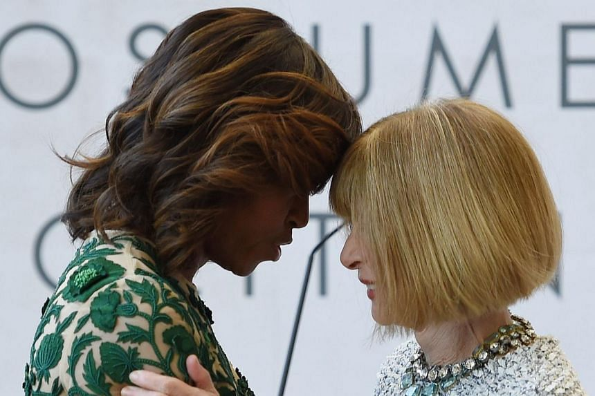 US First Lady Michelle Obama (left) and Vogue Magazine Editor Anna Wintour (centre) speak after Obama cut the ribbon officially opening The Costume Institute's new Anna Wintour Costume Center at The Metropolitan Museum of Art on May 5, 2014 in New