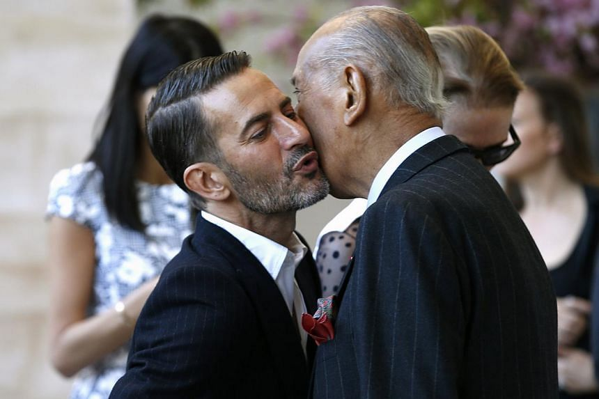 Fashion designers Marc Jacobs (left) and Oscar de la Renta greet each other as they attend a ceremony to open the Anna Wintour Costume Center at the Costume Institute at the Metropolitan Museum of Art in New York on May 5, 2014. -- PHOTO: REUTERS