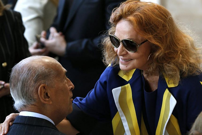 Fashion designers Diane Von Furstenberg (right) and Oscar de la Renta greet each other as they attend a ceremony to open the Anna Wintour Costume Center at the Costume Institute at the Metropolitan Museum of Art in New York on May 5, 2014. -- PHOTO: