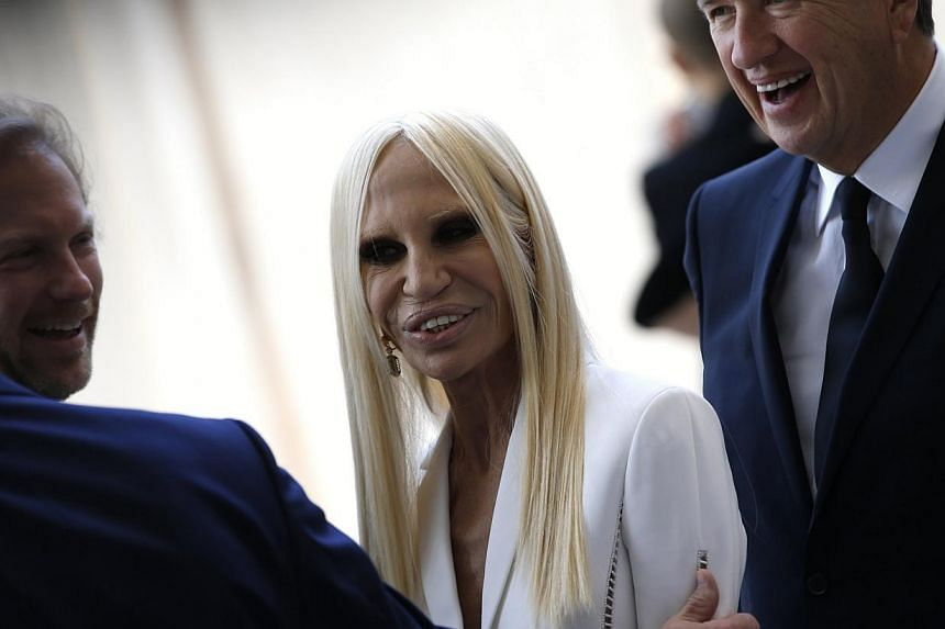 Fashion designer Donatella Versace (centre) is greeted by friends as she attends a ceremony to open the Anna Wintour Costume Center at the Costume Institute at the Metropolitan Museum of Art in New York on May 5, 2014. -- PHOTO: REUTERS