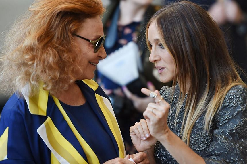 Fashion designer Diane von Fürstenberg (left) and actress Sarah Jessica Parker (right) at the official opening of The Costume Institute's new Anna Wintour Costume Center at The Metropolitan Museum of Art on May 5, 2014 in New York. -- PHOTO: AFP