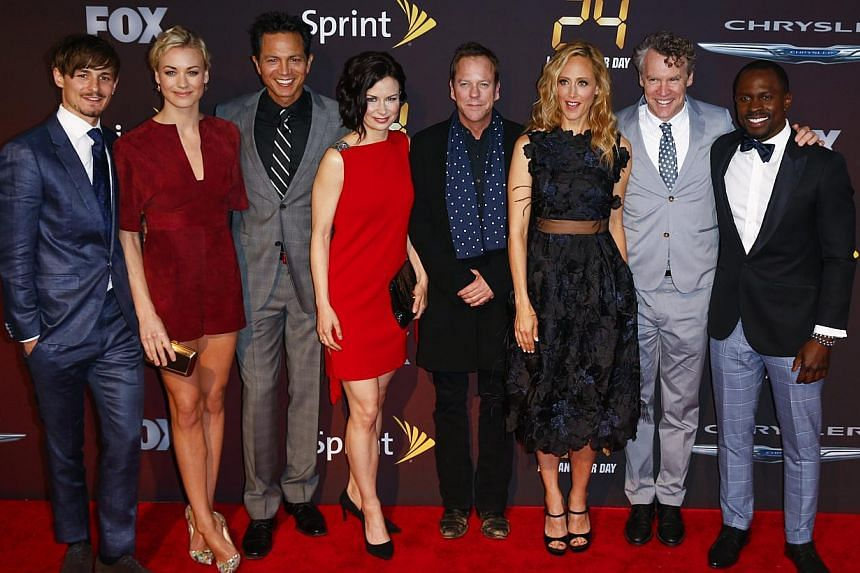 Cast members (left to right) Giles Matthey, Yvonne Strahovski, Benjamin Bratt, Mary Lynn Rajskub, Kiefer Sutherland, Kim Raver, Tate Donovan and Gbenga Akinnagbe arrive for the world premiere of the Fox series 24: Live Another Day in New York on May