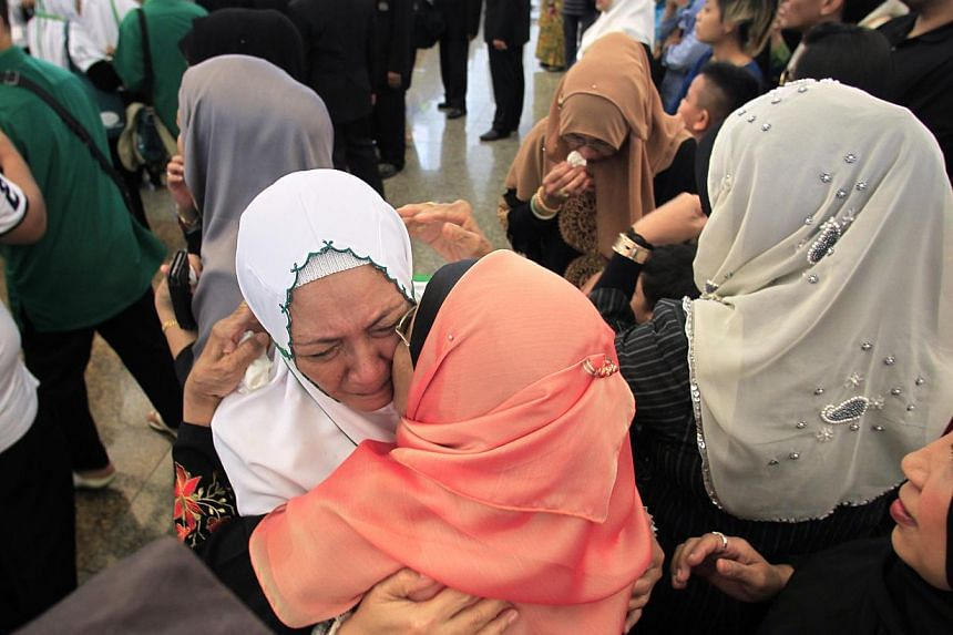Pilgrims getting an emotional farewell from family and friends at Changi Airport before leaving on the haj pilgrimage in September 2013. Singapore is stepping up precautionary measures against the deadly Middle East respiratory syndrome although no c