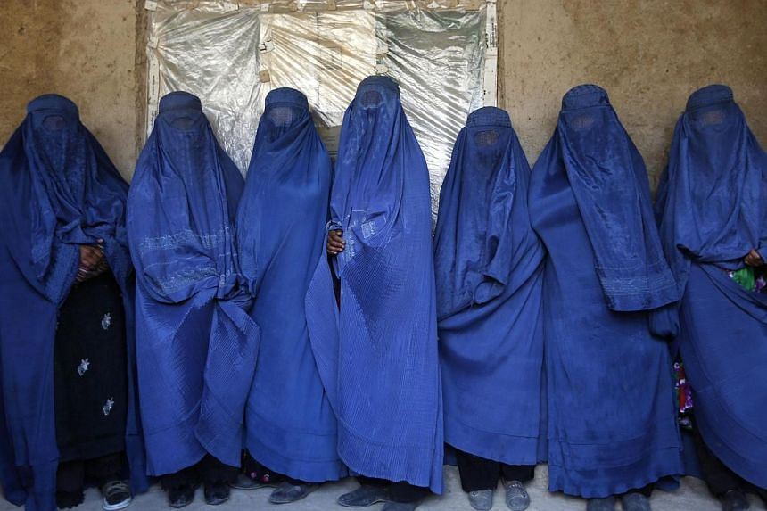 Afghan women mourn after dead body of woman was found at site of landslide at Argo district in Badakhshan province.As many as 2,700 people may be buried after a landslide in the Ab-e-Barak village in Badakhshan province in Afghanistan on May 2.