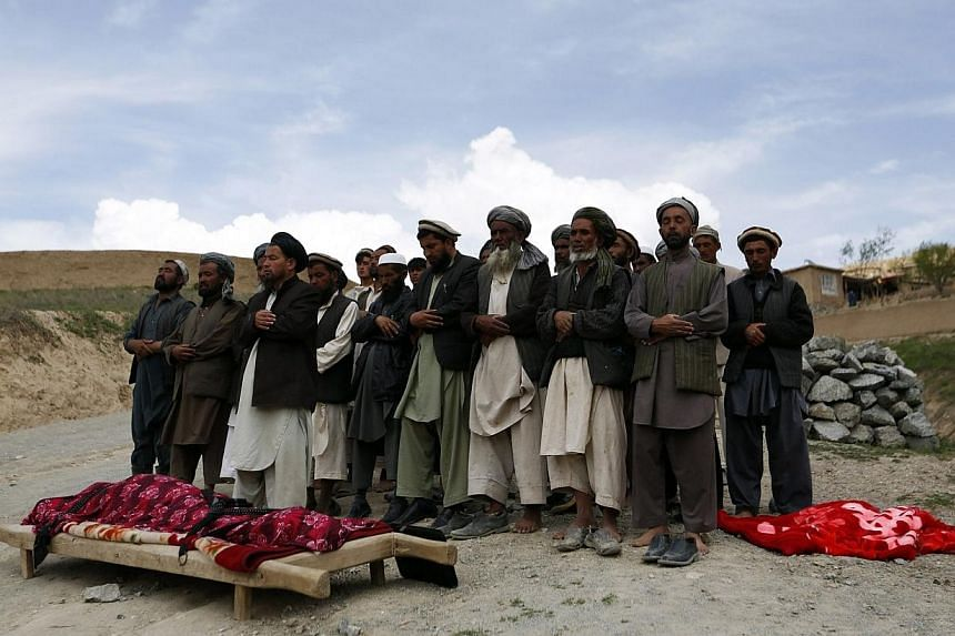 Afghan villagers pray during a funeral for a victim of a landslide at the Argo district in Badakhshan province.As many as 2,700 people may be buried after a landslide in the Ab-e-Barak village in Badakhshan province in Afghanistan on May 2. --