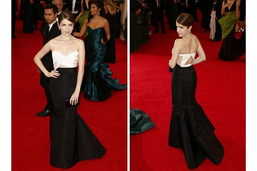 HOT OR NOT: Actress Anna Kendrick's polished up-do very well complemented the stunning black-and-white gown by J. Mendel. The gown's geometric front showed just enough skin to stun admirers. Something better could have been done with the gown's back