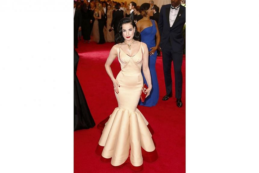HOT OR NOT: Dancer and model Dita Von Teese was classy as ever in a Zac Posen gown. The red hemline of her mermaid gown made it look like she was just floating effortlessly on the red carpet. Lovely, as always. -- PHOTO: REUTERS
