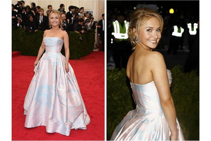 HOT OR NOT: Hayden Panettiere arrived at the 2014 Met Gala in a Dennis Basso gown. The dress looked rather simple and boring from afar, but carried details of what looked like a huge flower up close. Panettiere brightened up the ensemble with her wid