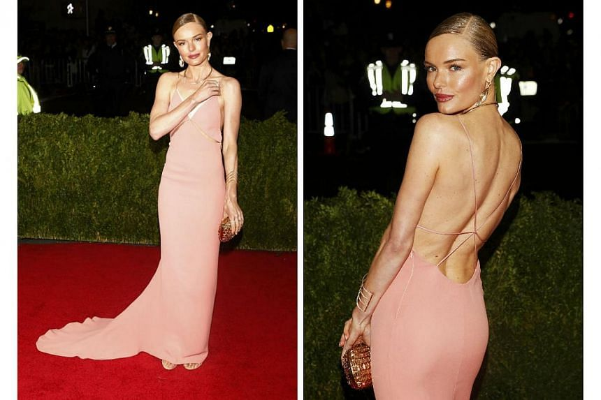HOT OR NOT: Actress Kate Bosworth was a picture of elegance in her Stella McCartney gown at the 2014 Met Gala. Do not be fooled by the seemingly sexy front as she showed a lot of skin when she turned her back. -- PHOTO: REUTERS
