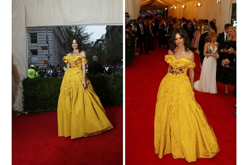 HOT OR NOT: This Marchesa gown looked Disney-inspired, but it seemed like Katie Holmes forgot to tell her fairy godmother that she was going to a ball. Either that, or a wicked witch messed up her ensemble just before she reached the castle - or in t