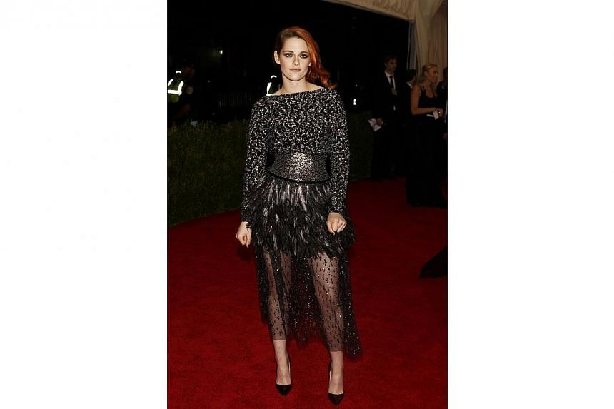 """HOT OR NOT: Feathers. Tulle. Sequins. Can you believe this is a Chanel on Kristen Stewart? Some have called the dress """"edgy"""". Some might refer to it as a mess of textures and elements. -- PHOTO: REUTERS"""