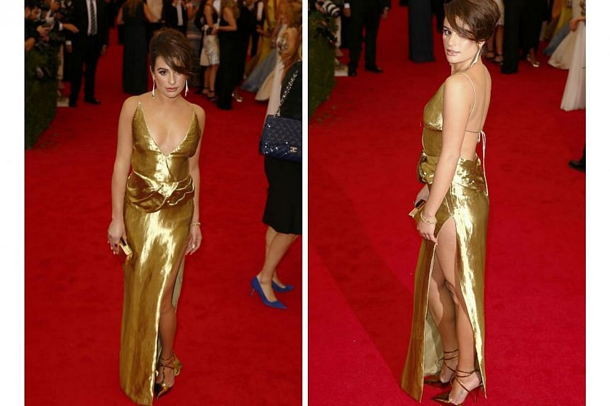 HOT OR NOT: Shining and shimmering actress Lea Michele in a gold Altuzarra gown. Too golden and a bit too tacky. And what was with that extra cloth on her mid-section? -- PHOTO: REUTERS