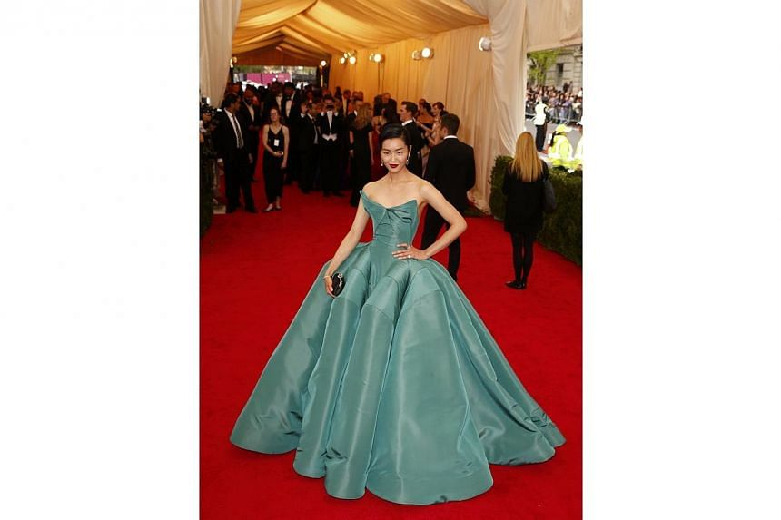 HOT OR NOT: Model Liu Wen arrived at the Metropolitan Museum of Art Costume Institute Gala Benefit in a satin Zac Posen gown. The top was nicely shaped but the voluminous skirt looked like there was a giant spider underneath whose legs were trying to