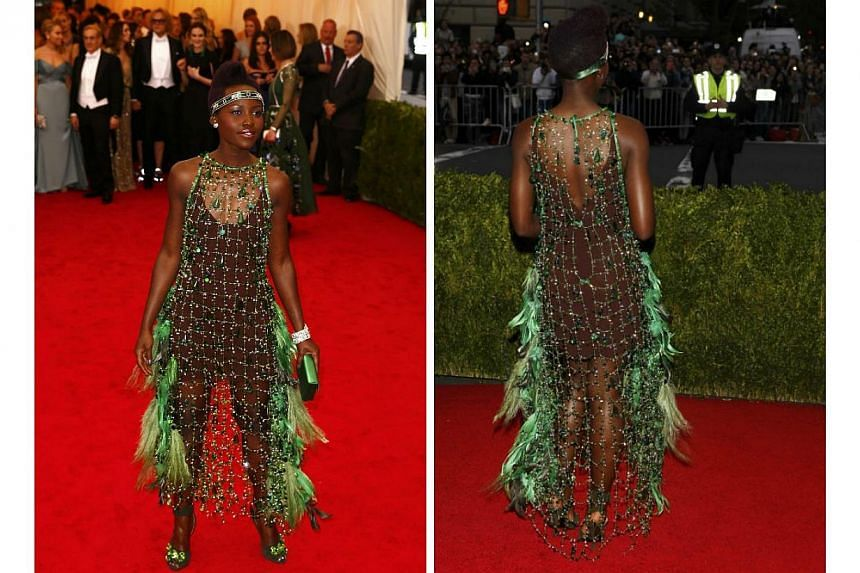 HOT OR NOT: Oscar-winning actress Lupita Nyong'o's 2014 Met Gala gown was far from the classic cuts we usually see her in on the red carpet. This Prada dress - feathers, gems and all - received mixed reviews from the fashion community.-- PHOTO: