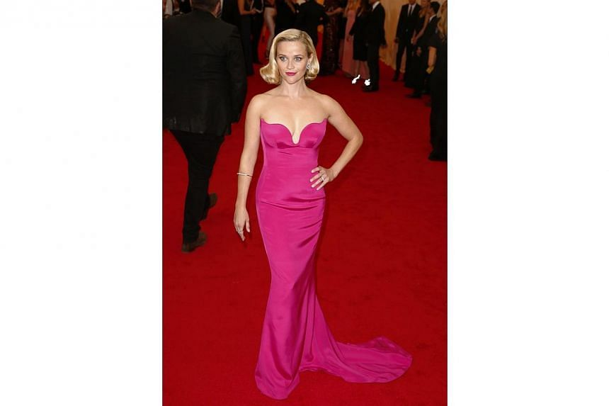 HOT OR NOT: Reese Witherspoon stood out on the red carpet with her hot pink Stella McCartney gown that was perfectly complemented by her wavy locks. -- PHOTO: REUTERS